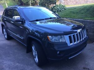 2011 Jeep Grand Cherokee with Factory Warranty remaining.