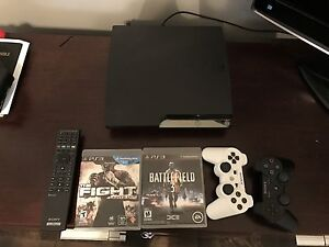PS3 with 2 controllers, 2 games, and aremote