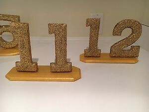 Gold glitter table numbers 1-31