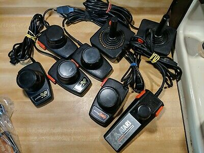 Atari 2600 7800 Controller Lot PADDLE JOYSTICK DRIVING 8 TOTAL