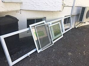 4 windows - 2 with awning open, 2 fixed