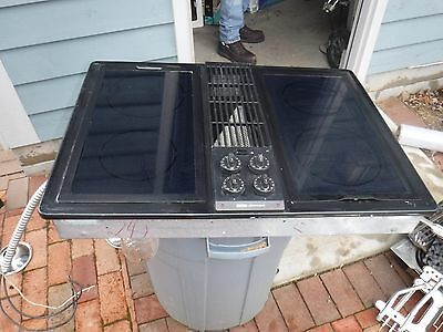jenn air downdraft c228b cooktop with black glass burners and grill unit