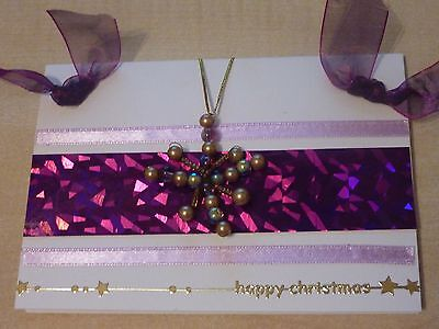 Made using snowflakes from Christmas crackers and ribbons from clothes