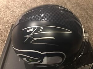 Full size Seattle Seahawks helmet autographed by Russell Wilson.