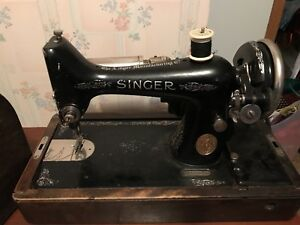 SINGER sewing machine in a locked wooden box.