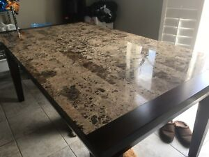 Large stone table with chairs