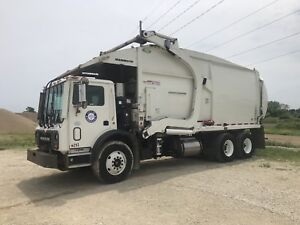 Two 2016 Mack front load garbage trucks