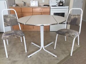 Cozy drop-leaf table and chairs.
