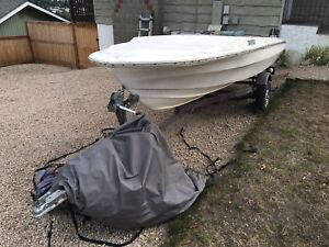 16ft project boat w/ 65hp mercury outboard and trailer