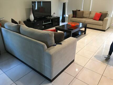Lounges with coffee table, side tables and entertainment unit