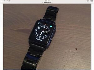Apple Watch with extra band and stand.