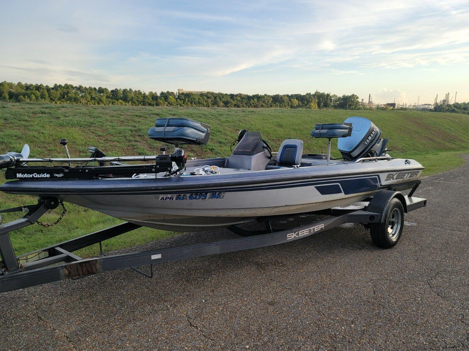 1993 ss140 Skeeter bass boat with 115 Yamaha motor