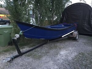 20ft wooden skiff and heavy duty trailer.  1000$