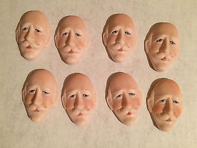 "Porcelain man/Male doll face front flat back  2.5"" long x 1 7/8"" widest  8 pc"