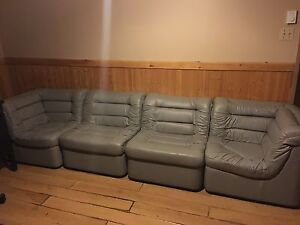Sectional sofa with chair. Vintage leather. Couch gray