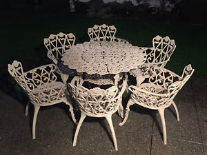 Patio set - wrought iron table & 6 chairs