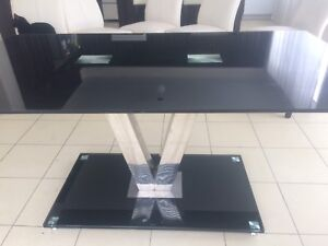 Large glass and chrome dining table