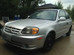 2003 Hyundai Accent for sale,ac works and snow tires