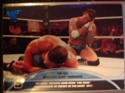 2013 Topps Best of WWE Top Ten Greatest Moments #9 CM Punk defeat John