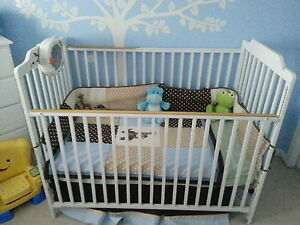White baby crib, change table and chair