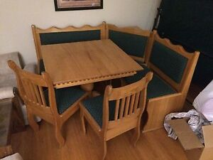 Corner table with bench and chairs.