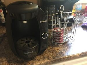 Tassimo coffee maker with pod carousel and coffee pods