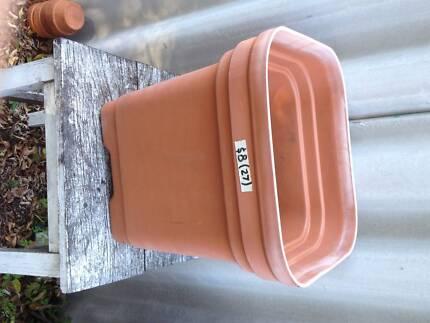 2 X large terracotta coloured square plastic pots