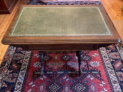 MAHOGANY ANTIQUE WRITING TABLE INLAID WITH LEATHER