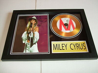 MILEY CYRUS    SIGNED  GOLD CD  DISC 1