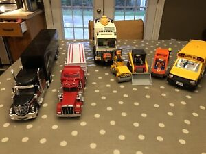 Lot of Playmobil toys and 2 semis