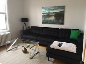 Black microfibre sectional for sale - $1000