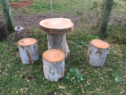 Rustic Table With Stump Chairs