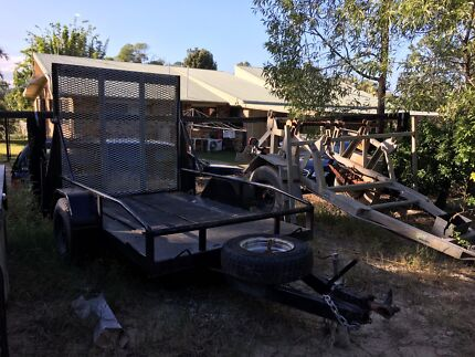 Trailer with fold down ramps