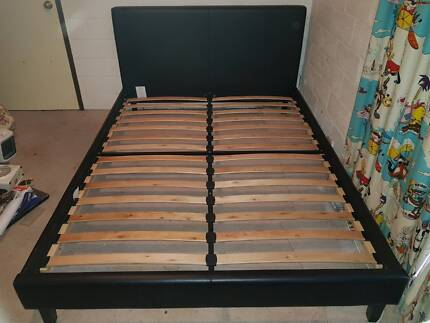 QUEEN SIZE WOODEN BED IN GOOD CONDITION. SELLING AS MOVING HOUSE.