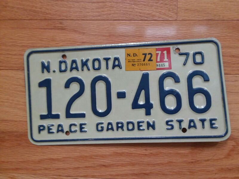 1970 Blue on White North Dakota License Plate with a 1971-72 Stickers