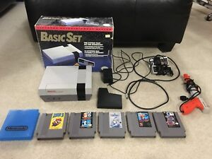 NES with box and 5 games