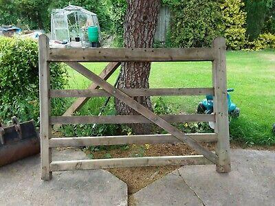 a   Wood estate 5 bar gate