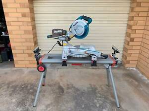 Makita 260mm compound mitre saw with Milwaukee stand