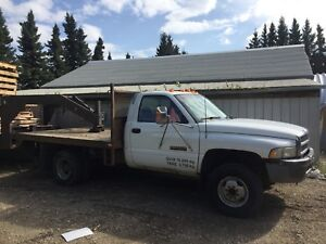 Dodge 1 ton flatbed, and fifth wheel trailer