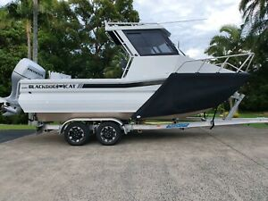 Black dog 620 cabin and 630 walk through stock demo boat sale