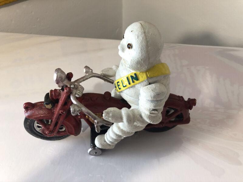 Michelin Man Bibendum on Red Motorcycle Cast Iron Toy, New