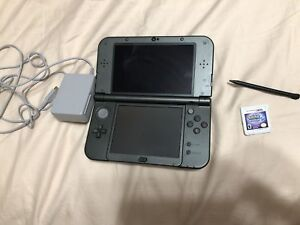 New Nintendo 3DS XL with charger and Pokemon Moon