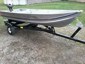 12 foot boat and motor pkg.