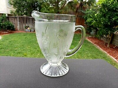 "IRIS AND HERRINGBONE JEANNETTE DEPRESSION GLASS 9½"" FOOTED PITCHER"