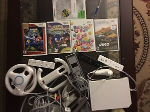 Nintendo Wii console with games and accessories. AVAILABLE