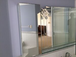 Bathroom mirror and mirrored shaving cabinet