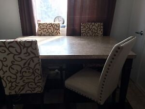 Real oak table with 4chairs excellent condition