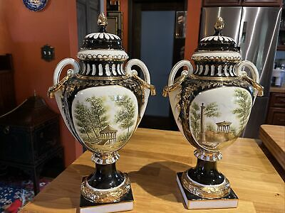 Pair hand painted black gold porcelain urns with lids french? Large