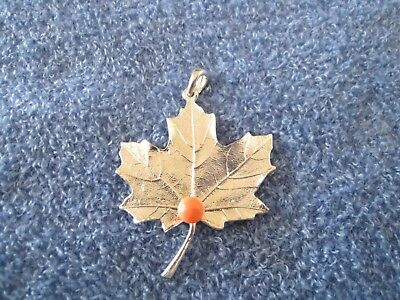MAPLE LEAF PENDANT, sterling silver, mounted coral, approx 1-5/8