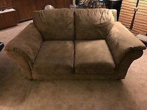 Tan loveseat couch